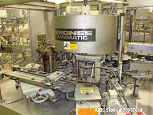 Used-Krones 8 Head Rotary Hot Melt Canmatic 8 Pinch Grip Labeler. 2 Glue pots. Set up for 128 oz round gallons. Includes sta...