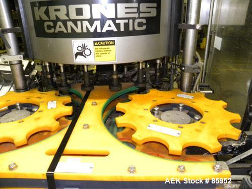 Used- Krones Canmatic Rotary Hot Glue Wraparound Labeler. 18 hd Capable of running up to 600 cpm. Container size range: 50-1...