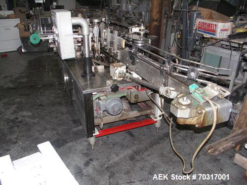 Used-Krones Rondella 88 Wrap Around Hot Glue Labeler capable of speeds up to 400 BPM. Glue is applied to the leading and tra...