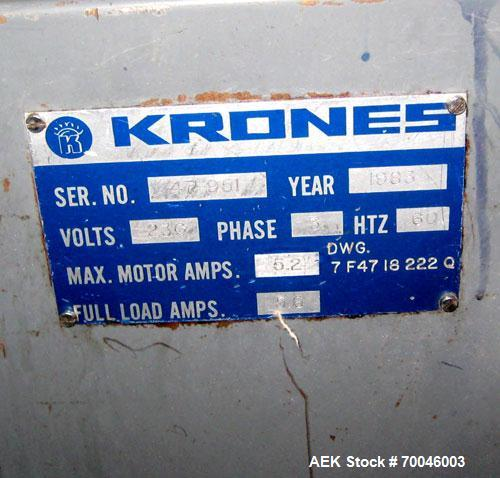 Used- Krones Rotina I Wraparound Cold Glue Labeler. Cable of speeds up to 80 bottles per minute on wraparound or 100 bottles...