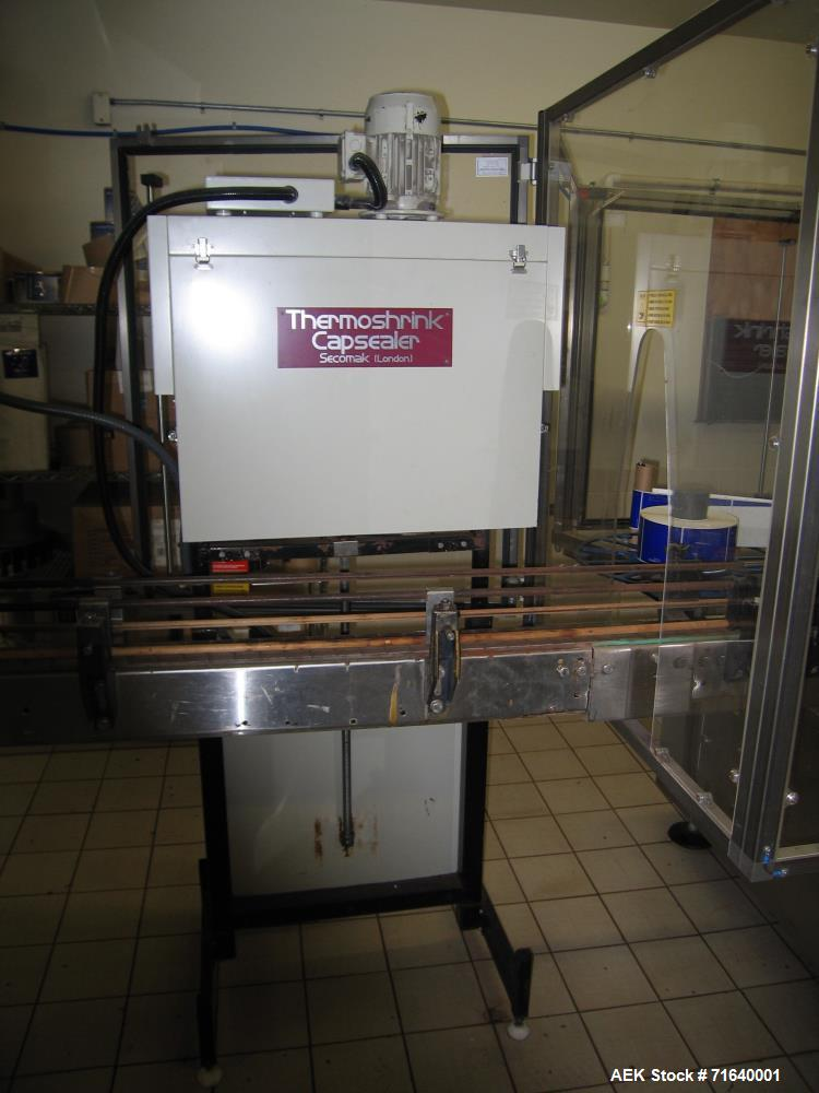 Used- MEB Pressure Sensitive Hi Speed Labeler, Model AD 3S. Includes Secomak Thermoshrink Capsealer and (5) sets of change p...