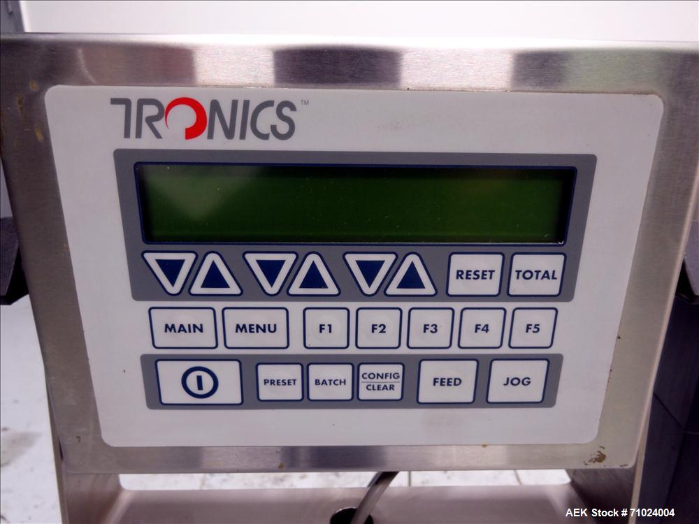 "Used- Tronics Model S1000 Stand Alone Pressure Sensitive Labeler. Capable of speeds up 1,200"" per minute. Has maximum label ..."