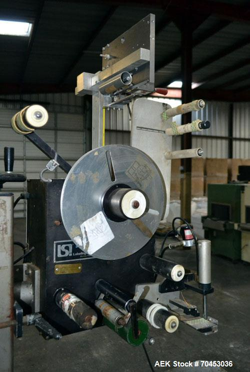 "Used- LSI Loose Loop Print & Apply Labeler, Model 1360, capable of 120 products per minute. Can accommodate up to 4"" x 4"" la..."