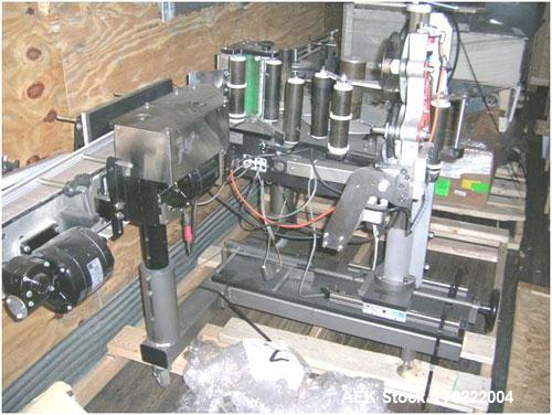 Used-LSI Spot Pressure Sensitive Labeler. Has conveyor and Norwood hot stamp coder.