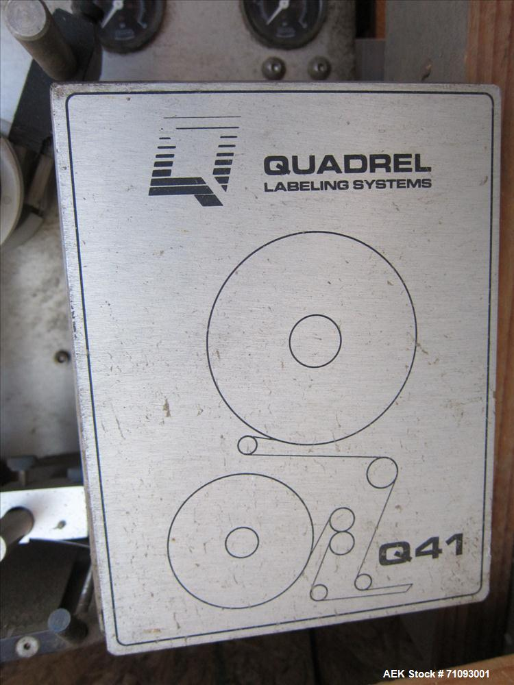 Used-Quadrel Model Q41 Pressure Sensitive Spot Labeler on T-Stand. Capable of speeds up to 300 per minute (Depending on labe...