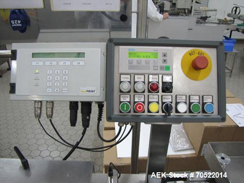 "Used-Etibe HKM-10 Labeling Machine.  Object diameter 0.5"" - 2.7"" (13 - 60 mm), maximum output 18,000 objects/hour, label hei..."