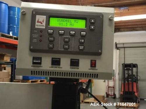 "Used- Quadrel model Q60 Wraparound Pressure Sensitive Labeler with Norwood Hot Stamp Coder. Has a 7"" labeling head serial nu..."