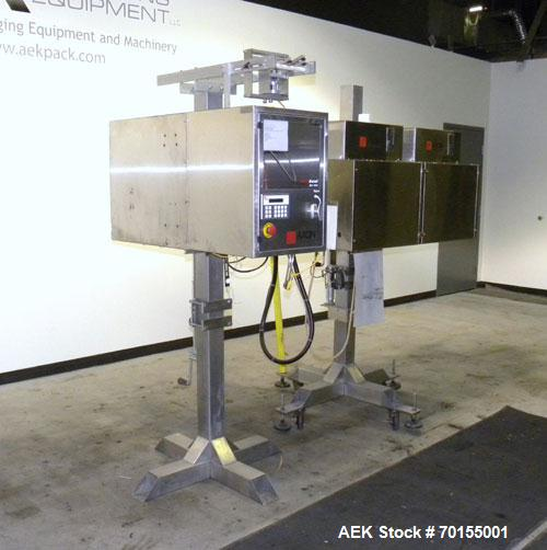Used- Axon Corporation EZ-100 Tamper Evident Band and Sleeve Label Applicator capable of speeds up to 150 packages per minut...