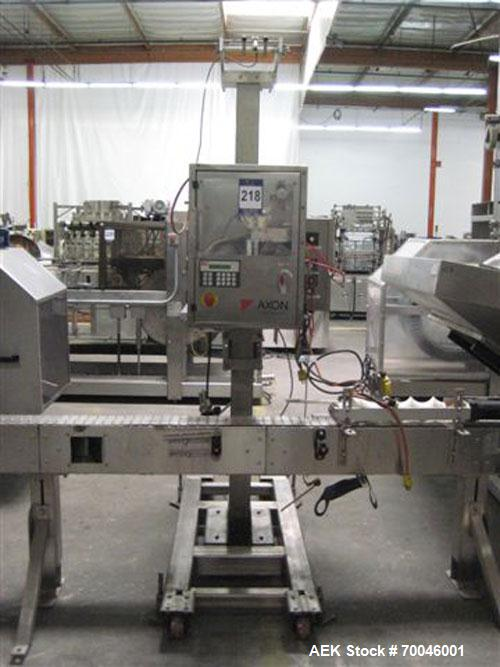 "Used- Axon ""Styrotech"" Sleeve Labeler or Tamper Evident Band Applicator, EZ-200 Series, Serial# E0201106. Machine is a singl..."