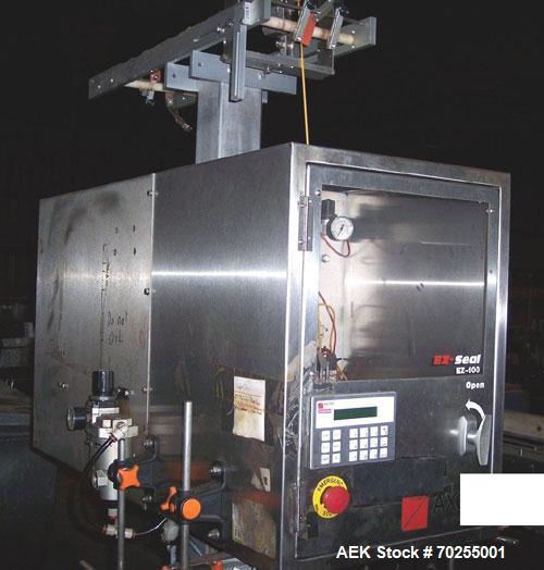 Used- Axon Shrink Neck Bander/Shrink Sleever, Model EZ100. Reg film, film perforation, over conveyor mounting. It is designe...