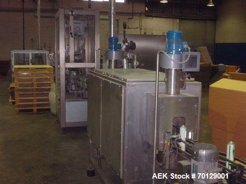 Used-Comag Shrink Sleeve for Aerosol Cans. Nominal speed 12,000 cans/hour, guaranteed speed 9,000 cans/hour. Consisting of: ...
