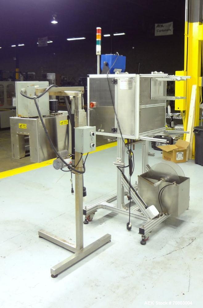Used- TriPack LSA-160 Automatic Shrink Sleeve Labeler Applicator / Neck Bander. Capable of speeds up to 100 BPM. Layflat wid...