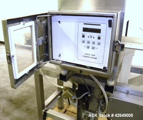 "Used- Goring Kerr Metal Detector, Model TEK 21 DSP. Usable aperture size 7-7/8"" wide x 4-1/4"" high. Includes a plastic belt ..."