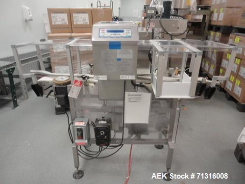 Used-Loma Model IQ2 Metal Detector with conveyor and reject. Metal detector is vertical and last set up for solid dose bottl...