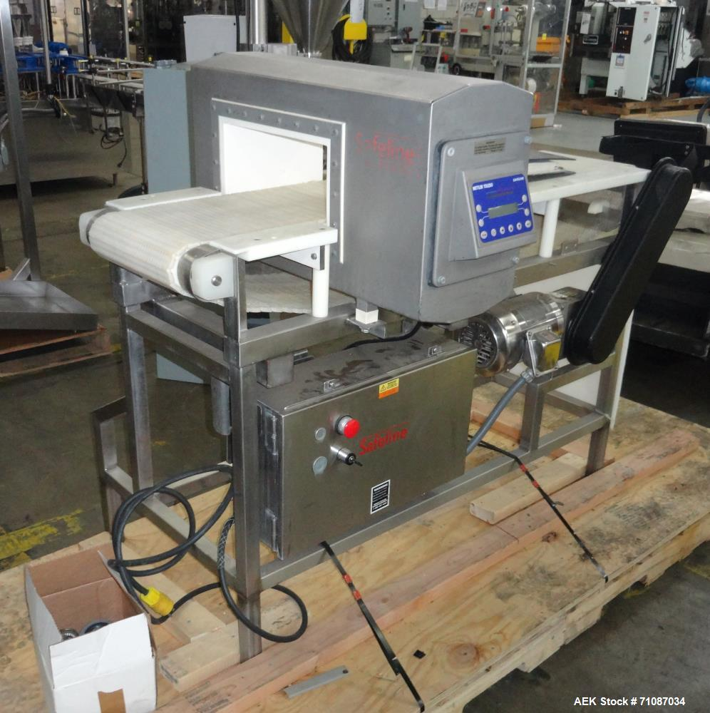 "Used- Mettler-Toledo Model SL 1200 Safeline Metal Detector.  Has a 13 1/2"" x 7"" high aperature.  Mounted over a 60"" long x 1..."
