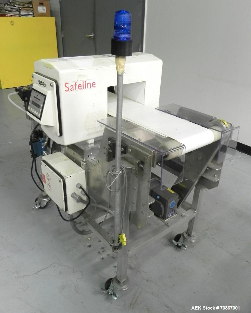 """Used-Safeline Model 250X150 Metal Detector. Has a 10"""" (wide) by 5.25"""" product aperature. Mounted on a Goring Kerr 48"""" (long)..."""