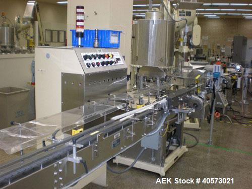 Used: Lakso model 71 automatic twin head cottoner capable of speeds up to 200 BPM. Has screw infeed automatic bottle .Has fa...