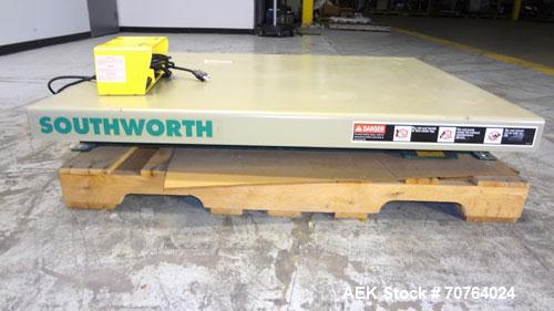 "Used- Southworth Systems Pallet Lift. Machine is rated at a 2000 lb capacity. Has a lift area of 48"" X 42"". 1/30/115V. Built..."