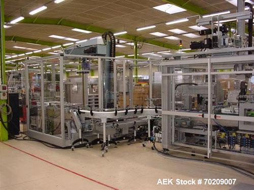 Used- Cermex Sidel P922 Gantry Style Palletizer capable of speeds up to 12 cycles per minute. Has 4 axis gripping transfer s...