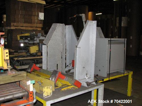 Used-Samsung Model FARA PL2 Robotic Palletizer, with controls, and inbound and outbound infeed conveyors.