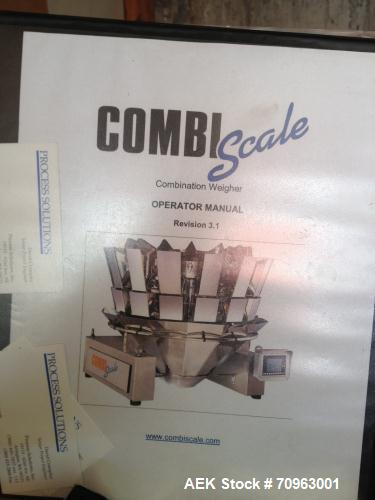 Used-Combi Scale 10 Head Scale.  Stainless steel smooth bucket.  Rated up to 140 cycles per mnute.  Includes controls.