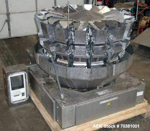 Used- Ishida model CCM-Z-216B-D/30-WP 16 head dimpled bucket combination scale. Has booster buckets for a total of 32 bucket...