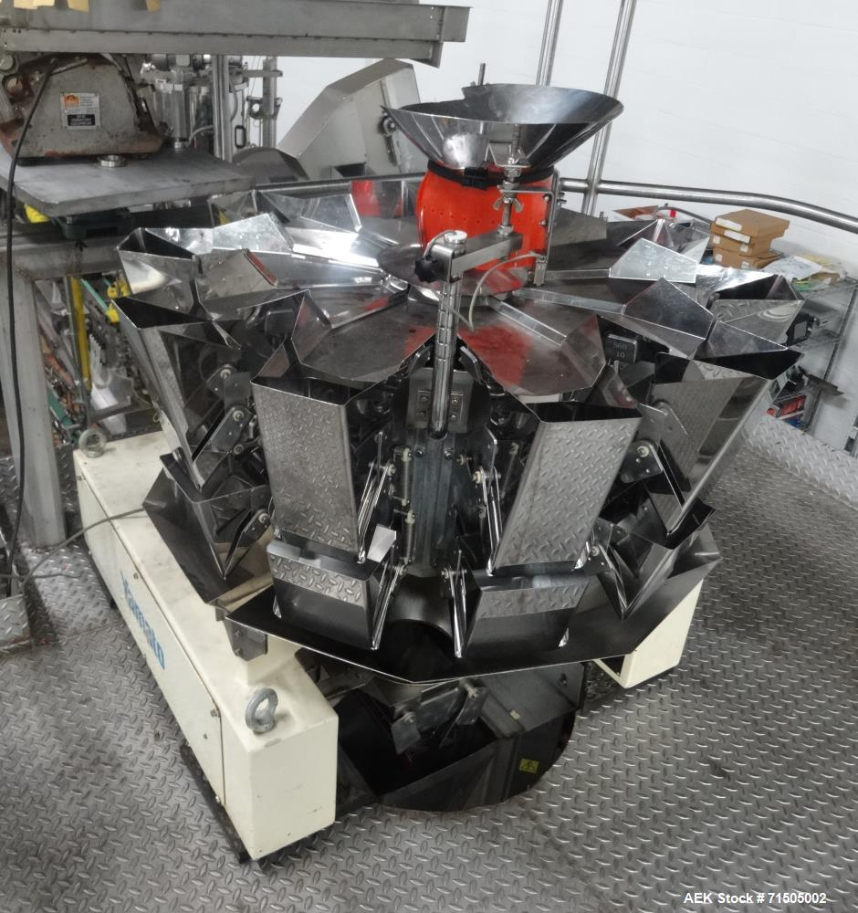 Used- Yamato ADW-510HC radial combination 10 head scale. Capable of speeds up to 70 weighments per minute. Max weighments: 3...