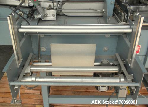Used- Shanklin Automatic L Sealer and Shrink Wrapper, Model A-23, Carbon Steel.  Capable of speeds up to 40 packages per min...
