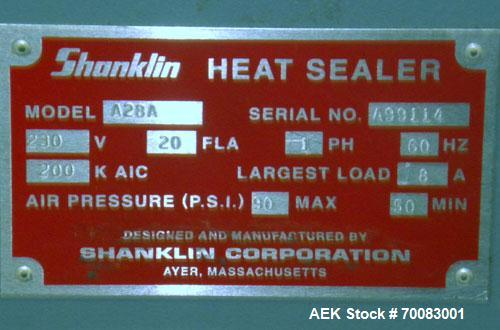"Used- ShanklinAutomatic L Bar Sealer, Model A28A. Capable of speeds up to 25 Packages per minute. Seal size 31"" wide x 43"" l..."