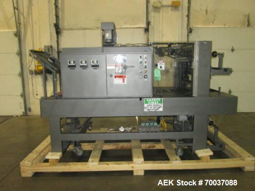 "Used- Arpac, Model 55-28 Shrink Bundler with Heat Tunnel. Dual rolls with top and bottom film loading. 28"" x 14"" size range...."