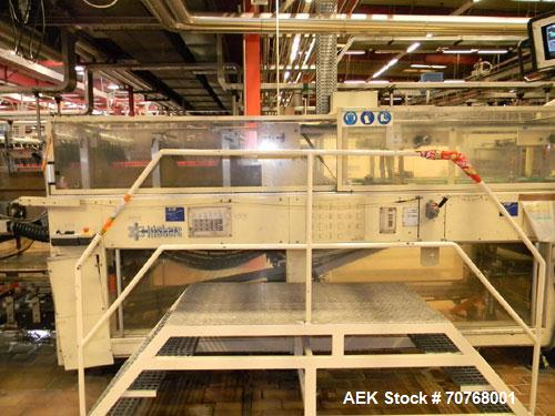 Used-Kisters 198/60 DZ Shrink Wrapper including infeed, outlet conveyors and magazine for carton pads.  For PET bottles 17, ...