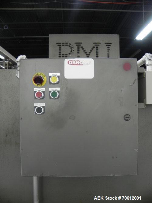 Used- PMI Model SIC-30 Automatic Shrink Bundler & Shrink Tunnel. Machine is rated at up to 30 packages per minute. Tray wrap...