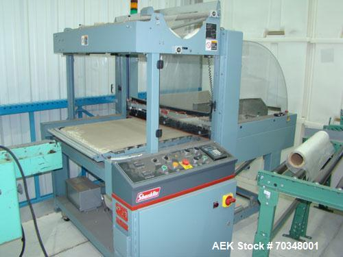 Used-Used: Shanklin B2BB shrink wrapper bundler with Shanklin T-9 shrink tunnel. Has 40 in seal jaw, AB Micrologics 1000 plc...