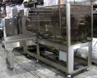 Used-Poly Pack Model FH16 Stainless Steel Shrink Bundler. Machine is capable of speeds up to 30 bundles per minute. Has righ...