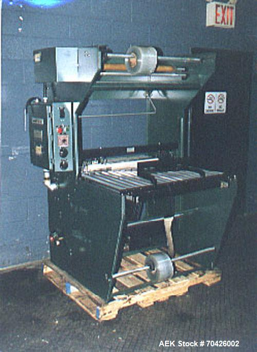 "Used-Weldotron Model 1205A Sleeve Wrapper with 32"" seal bar, temperature and dwell controls, hand load, roller bar discharge..."
