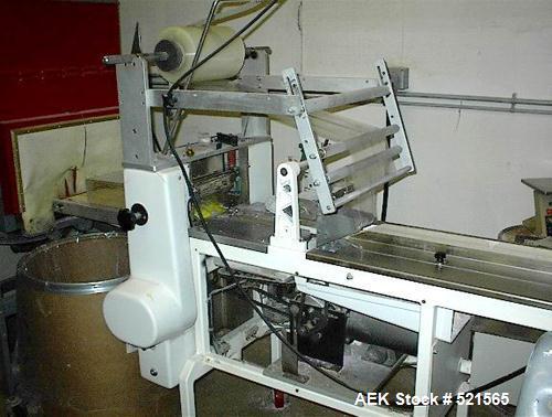 USED: PFM model 30 horizontal flow thru shrink wrapper. Includes Seal-A-Tron tunnel model TXST 1811-LR15.