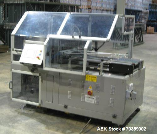 Used-Comipack Horizontal Side Sealer, Model CM-50-2N.  Continuous side seal unit composed of 3 sets of wheels for the feedin...
