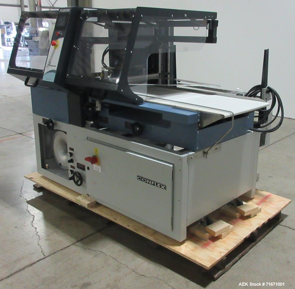 "Used-Conflex Fusion Intermittent Motion Side Seal Shrink Wrapper. Capable of speeds up to 100' of film per minute. Has a 24""..."