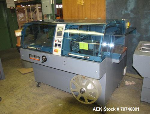 "Used-Hugo Beck Super Series 500 Shrink Film Packaging Machine.  All electric intermittent side seal machine.  19"" Wide, 8"" h..."