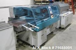Used- Hugo Beck Full Shrink System; Includes: Infeed finger conveyor, tunnel SL 5015/23, exit flat belt conveyor. Dimensions...