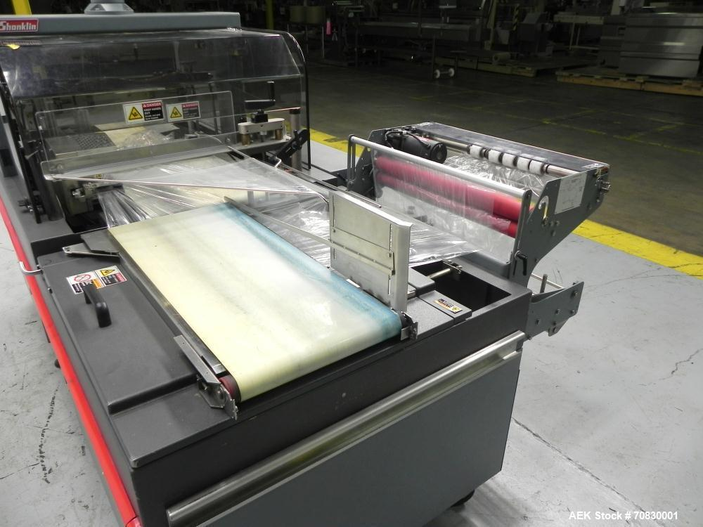 Used- Shanklin Triumph Model TR1 Horizontal Side Seal Shrink Wrapper capable of speeds up to 60 jaw cycles per minute (depen...