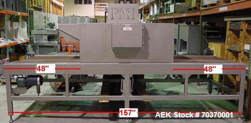 """Used-Used: PMI heavy duty shrink tunnel with a chamber is 48"""" wide X 12"""" high x 60"""" long. With  48"""" extended  to infeed & di..."""