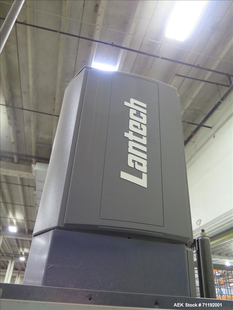 Used-Lantech Stretch Wrapper, Model Q1000 Serial # QA 002180.  Automatic operation with powered infeed and discharge pallet ...