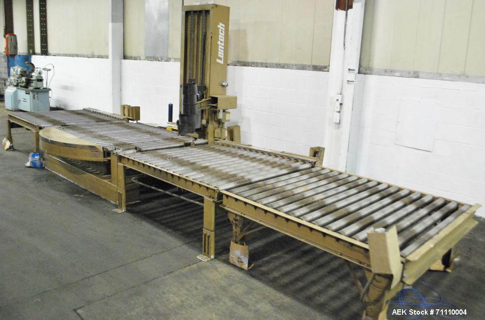 Used- Lantech Automatic Stretch Wrapper, Model SVAMP.  Infeed/outfeed conveyor.  4,000 Lbs table capacity.  1-12 Rpm, produc...