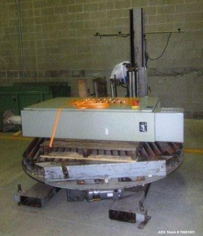 Used- Orion FA44-267 Rotary Integrated stretchwrapper. Includes approx 24 feet driven Roller Pallet Conveyor and discharge. ...