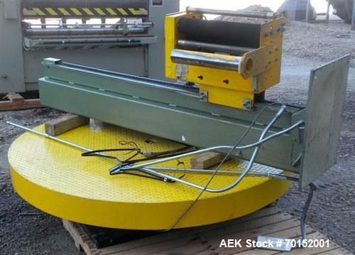 "Used- ITW Mima Semi-Automatic Spiral Web Stretch Wrapper, model FE-HP, carbon steel. Up to 30 loads per hour. 72"" diameter t..."