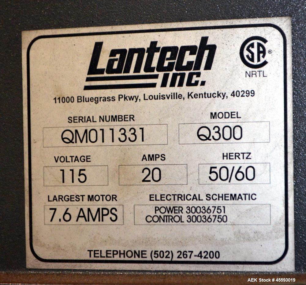 "Used- Lantech Model Q300 Stretch Wrapper. 72"" Diameter turntable. 115 Volt, 20 amp, 50/60 hertz. In floor mounted. Serial#QM..."