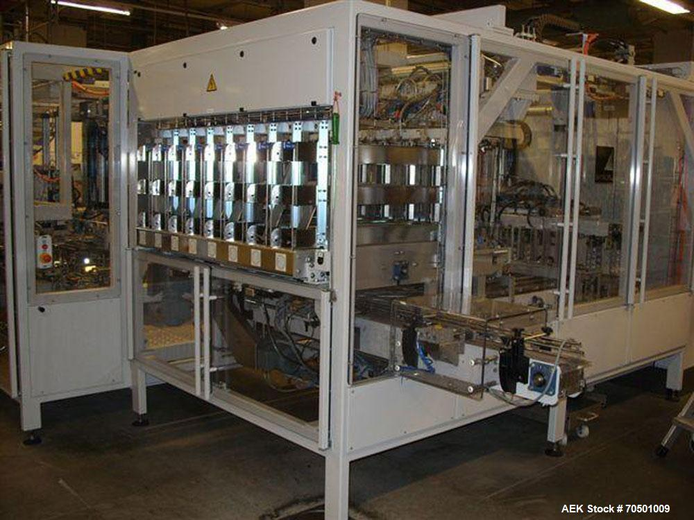 """Used-Power Food Tray Packer.  Capacity 40 cartons/min, 6 cups per carton.  Packing size 27.5"""" x 6.6"""" x 0.05"""" (699 x 168 x 1...."""