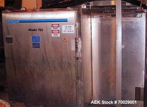Used-Doboy (Delkor) Automatic Trayformer 752. Dual head tray former capable of speeds up to 150 TPM,  stainless steel cabine...