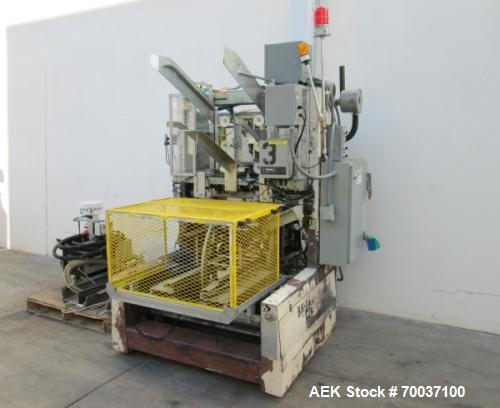 "Used- SWF Model 1D5A Bliss Trayformer, can run up to speeds of 12-35 boxes per minute. Box sizes: 9-1/4"" to 31-7/8"" in lengt..."